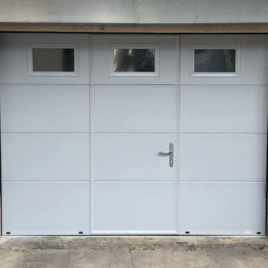Porte de garage sectionnelle avec portillon Gypass activa